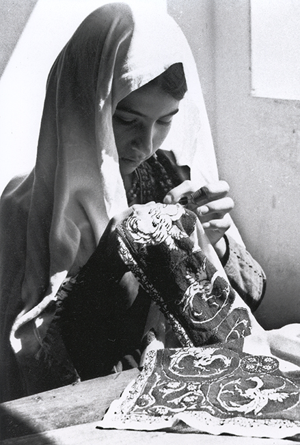 Palestinian girl making embroidery, 1939
