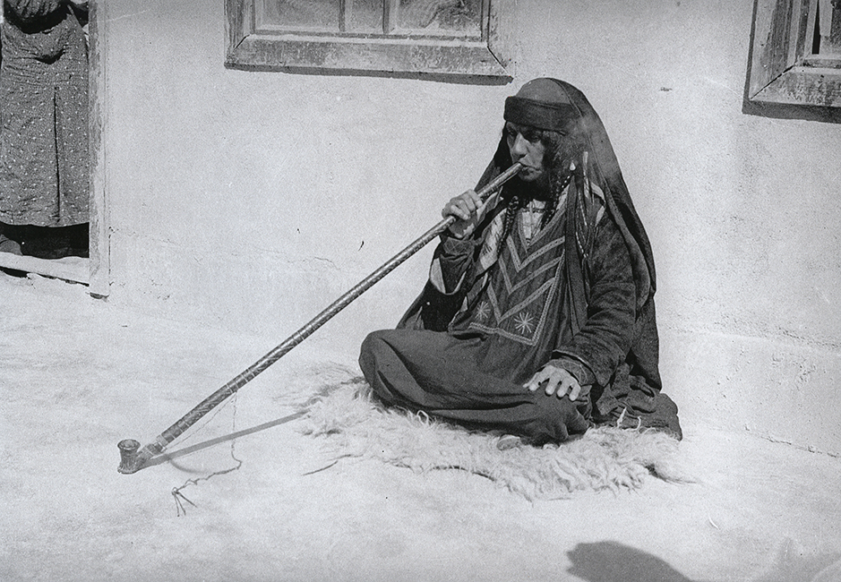 Palestinian woman smoking a pipe, 1935