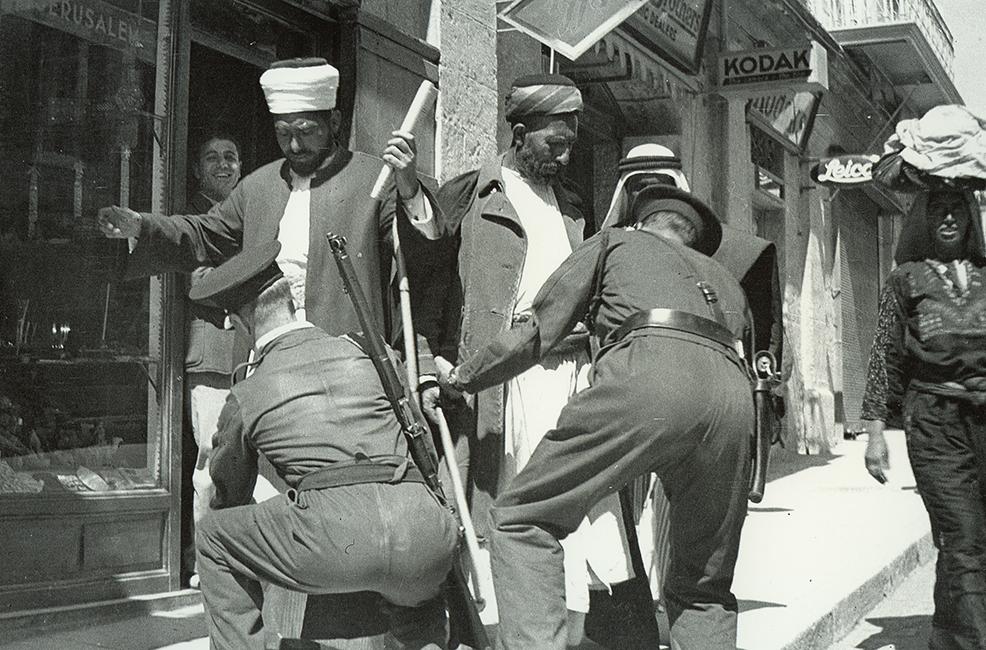 British policemen frisking Palestinians, 1936